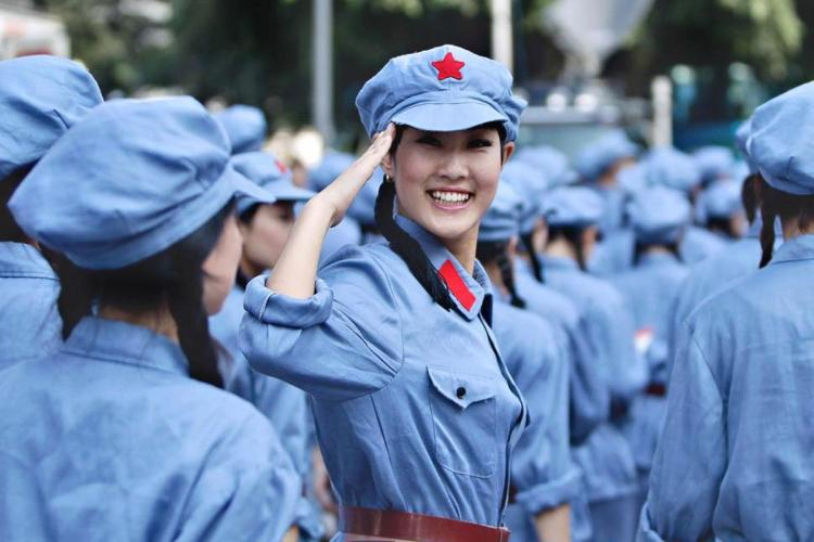 A performer dressed in Red Army uniform salutes at a revolutionary song singing event to celebrate the upcoming 90th anniversary of the founding of the Communist Party of China (CPC), in Chongqing municipality